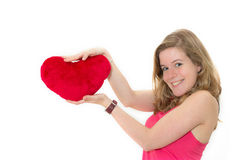 Woman holding a red heart Royalty Free Stock Photos