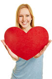 Woman holding red heart as love symbol Stock Photo