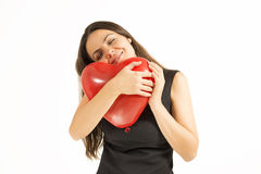 Woman holding red heart balloon Stock Photos