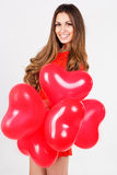 Woman holding red heart balloons Royalty Free Stock Images