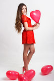 Woman holding red heart balloons Royalty Free Stock Photography