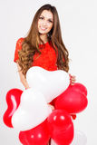 Woman holding red heart balloons Royalty Free Stock Image