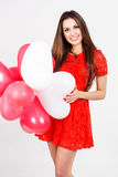 Woman holding red heart balloons Stock Photos
