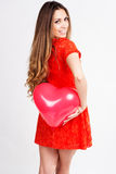 Woman holding red heart balloons Royalty Free Stock Photos