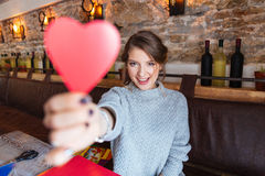 Woman holding red heart Royalty Free Stock Photography