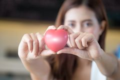 Woman holding red heart in hands. Woman holding red heart in hands Royalty Free Stock Images