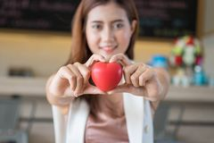 Woman holding red heart in hands. Woman holding red heart in hands Stock Photo