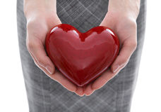 Woman holding a red heart in her hands Royalty Free Stock Photography