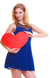 Woman holding red heart love symbol with blank copy space. Valentine's Day. Isolated. Royalty Free Stock Image