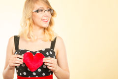 Woman holding red heart love symbol Royalty Free Stock Photos