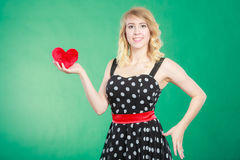 Woman holding red heart love symbol Stock Photography