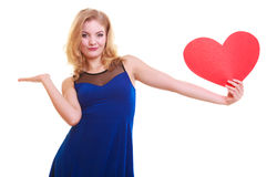 Woman holding red heart love symbol and having blank copy space on her hand. Valentine's Day. Isolated. Royalty Free Stock Image