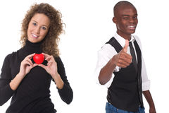 Woman holding red heart and man with thumb up Stock Photos