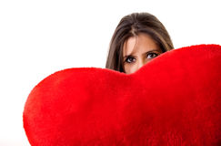 Woman holding a red heart with expression Royalty Free Stock Photos