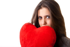 Woman holding a red heart with sexy expression Stock Photos