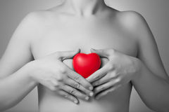 Woman with a red heart. Woman holding a red heart shape Royalty Free Stock Photos
