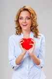 Woman holding red heart symbol Stock Photos