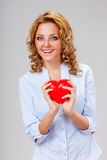 Woman holding red heart symbol Stock Images
