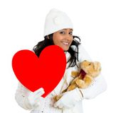 Woman holding red heart and teddy bear Royalty Free Stock Photography