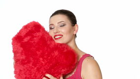 Woman holding red heart . Valentine`s day. Beautiful brunette woman with red lipstick hugging a big red heart on white background. Valentine`s day stock video footage