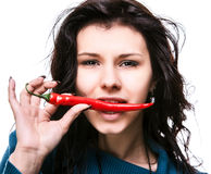 Woman Holding Red Hot Chili Pepper In Mouth Royalty Free Stock Photography