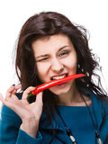 Woman holding red hot chili pepper in mouth Royalty Free Stock Images