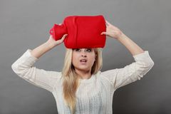 Free Woman Holding Red Hot Water Bottle On Head Royalty Free Stock Photography - 139096507