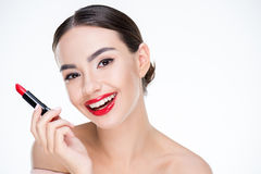 Woman holding red lipstick Stock Photos