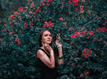 Woman Holding Red Petal Flower in Shallow Focus Photography stock photos