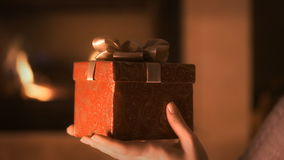 Woman holding red present box in hands stock video footage