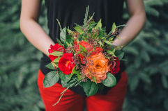 Woman holding a red rose bouquet Royalty Free Stock Photo