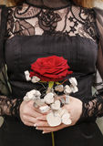 Woman holding red rose decorated with wooden hearts Stock Photography