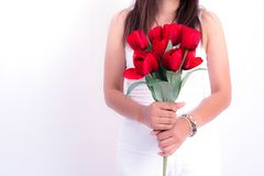 Woman holding red rose flower. Valentines day and  Couples conce. Pt. Love and Flirting theme. Close up at rose. Body part and headless theme Royalty Free Stock Photography