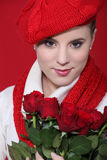 Woman holding red roses Stock Photos