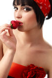 Woman holding a red strawberry Stock Photos