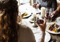 Woman Holding Red Wine Glass in a Classy Restaurant Royalty Free Stock Image