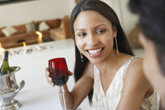 Woman Holding Red Wine Glass At Dinner Party Royalty Free Stock Photo