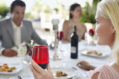 Woman Holding Red Wineglass At Party Royalty Free Stock Photo