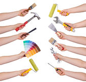 Woman holding redecorating tools. Isolated on white Stock Photography