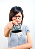 Woman holding remote control royalty free stock images