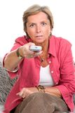 Woman holding remote control Stock Images