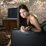 Woman holding remote control Royalty Free Stock Photography