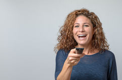 Woman holding a Remote Control Stock Photos