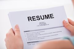 Woman holding resume Stock Photography