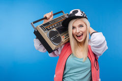 Woman holding retro boom box stock photography