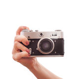 Woman holding  retro camera on white background Stock Photography