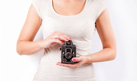 Woman holding a retro camera Stock Images