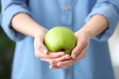 Woman holding ripe green apple. Closeup Royalty Free Stock Photography