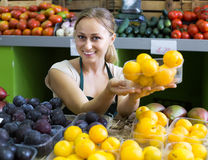 Woman  holding ripe plums Royalty Free Stock Images