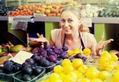 Woman  holding ripe plums Stock Photography